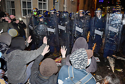 """© Licensed to London News Pictures;26/03/2021; Bristol, UK. Police using shields, batons and police horses push back demonstrators from Bridewell Police station at a third """"Kill the Bill"""" protest in Bristol this week takes place against the Police, Crime, Sentencing and Courts Bill during the Covid-19 coronavirus pandemic in England. The Bill proposes new restrictions on protests. Lockdown restrictions have been partly lifted to allow people to gather outdoors socially in households, bubbles, or to meet one person from another household, but the police say protests are not allowed under the current Covid regulations. Photo credit: Simon Chapman/LNP."""