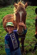 Boy with horse, Hawaii<br />