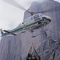 A helicopter ferries picks up a climbing expedition after the team spent six weeks climbing the wall in the background, north of the Arctic Circle on Canada's Baffin Island.
