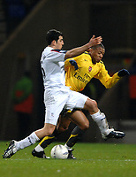 Photo: Paul Greenwood.<br />Bolton Wanderers v Arsenal. The FA Cup. 14/02/2007. Bolton's Tal Ben Haim, left, muscles Arsenal's Julio Baptista off the ball