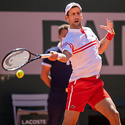 PARIS, FRANCE June 13.   Novak Djokovic of Serbia in action against Stefanos Tsitsipas of Greece on Court Philippe-Chatrier during the Men's Singles Final at the 2021 French Open Tennis Tournament at Roland Garros on June 13th 2021 in Paris, France. (Photo by Tim Clayton/Corbis via Getty Images)
