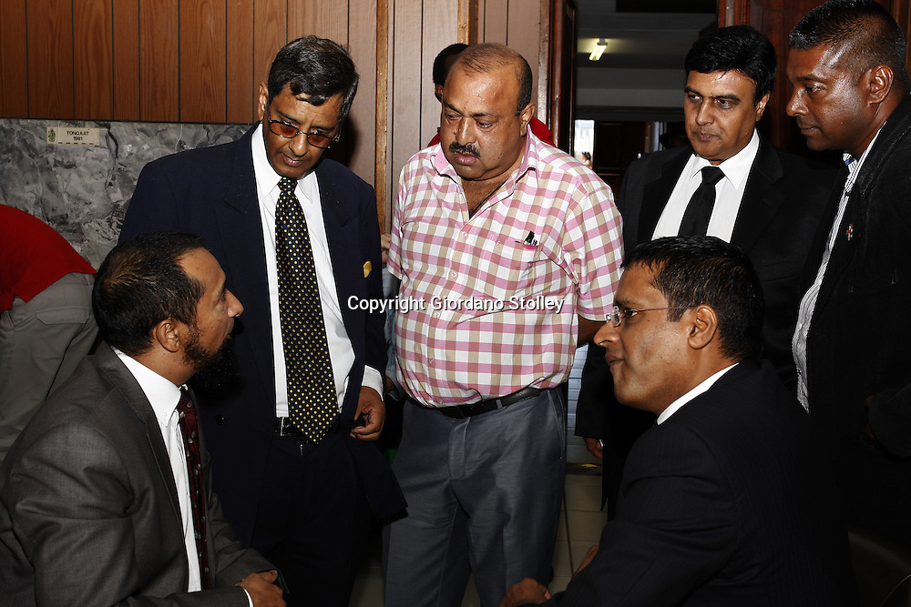 DURBAN - 11 February 2014 - Controversial businessman Jay Singh (centre, red and white shirt) consults with his legal team and pastor at the Department of lasbour's commission of inquiry investigating the events that led to the Tongaat Mall collapsing, killing two people and injuring 29 on November 19, 2013. Singh's son Ravi Jagadasan is a director of the developer Rectangle Investments while Singh is believed to pull the strings at Gralio Precast (Pty) Ltd, thecompany that was building the mall. From left are Advocate Saleem Khan, Kissoon Singh (legal consultant for Gralio and Rectangle) , Jay Singh, lawyer Omprakash Ramlakhan, Pastor Mervyn Reddy and seated on the right is Singh's attorney Rajan Naidoo. Picture: Allied Picture Press/APP