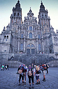 Pilgrimes arrive at the Cathedral of Santiago de Compostela after a long trek across Northern Spain.