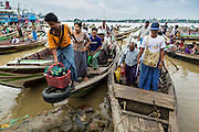 09 JUNE 2014 - YANGON, MYANMAR: People get off cross river boats on the Yangon side of the Yangon River near the San Pya (also spelled Sanpya) fish market. San Pya Fish Market in Yangon is one of the largest wholesale fish markets in Yangon. The market is busiest in early in the morning, from before dawn until about 10AM.    PHOTO BY JACK KURTZ