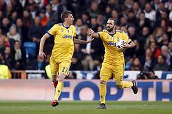 (l-r) Mario Mandzukic of Juventus FC, Gonzalo Higuain of Juventus FC during the UEFA Champions League quarter final match between Real Madrid and Juventus FC at the Santiago Bernabeu stadium on April 11, 2018 in Madrid, Spain