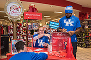 University of Kentucky football players Landon Foster, left, Max Strong, center, and Farrington Huguenin write letters to Santa as part of Macy's Believe campaign on National Believe Day Friday, Dec. 11, 2015 at Macy's Oxmoor in Louisville, Ky. (Brian Bohannon/AP Images for Macy's)