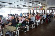 Passengers aboard a Star Ferry fron Central to Tsim Sha Tsui. Founded in the late 1800's the Star Ferry Company still runs today and is one of Hong Kong's most classic sights, much like Red Buses in London. There are various services which run from different points on the Kowloon side and Hong Kong Island.