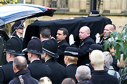 © Licensed to London News Pictures. 04/10/2012. Manchester, UK . The coffin is carried from the church after the service . 100s of police in Manchester city centre for the funeral of PC Fiona Bone at Manchester Cathedral . Bone was murdered in a gun and grenade attack alongside PC Nicola Hughes when responding to a suspected burglary at a house in Hattersley in Tameside on 18th September . Dale Cregan is currently on remand , accused of the two murders . Photo credit : Joel Goodman/LNP