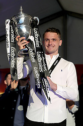St Mirren captain Stephen McGinn with the trophy during the winner's parade through Paisley.