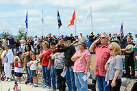 Audience members during the Pledge of Allegiance at Monday's somber Memorial Day remembrances at the Monterey County Vietnam Veterans Memorial in Salinas.
