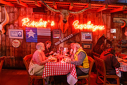 Patrons at Riscky's BBQ, Fort Worth Stockyards National Historic District, Fort Worth, Texas, USA.