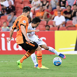 BRISBANE, AUSTRALIA - FEBRUARY 21: Chanathip Songkrasin of Muangthong United and Jack Hingert of the Roar in actionduring the Asian Champions League Group Stage match between the Brisbane Roar and Muangthong United FC at Suncorp Stadium on February 21, 2017 in Brisbane, Australia. (Photo by Patrick Kearney/Brisbane Roar)