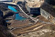 Nederland, Limburg, Maastricht, 07-03-2010; Sint-Pietersberg, mergelgroeve voor de winning van mergel (eigenlijk kalksteen) in dagbouw door cementfabriek ENCI. Wat er nog resteert van de St.Pietersberg (r) is beschermd natuurgebied en bovengronds en ondergronds aangewezen als beschermd Habitatrichtlijngebied..Marl quarry for the extraction of marl (limestone actually) in surface mining by cement factory ENCI. What is left of the Sint-Pietersberg is designated as protected area, both on groundlvel and underground the habitat directives apply..luchtfoto (toeslag), aerial photo (additional fee required);.foto/photo Siebe Swart