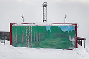 A wall adorned with posters of green trees stands in the Russian coal mining community of Barentsburg, in the Norwegian Arctic archipelago of Svalbard.
