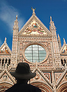 The decorated facade of the Duomo di Siena, the Cathedral of Siena, a Roman Catholic church in Siena, Tuscany, Italy