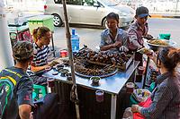 YANGON, MYANMAR -NOVEMBER 25, 2016 : people eating  street food at Yangon (Rangoon) in Myanmar (Burma)