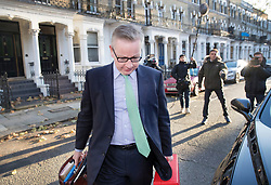 © Licensed to London News Pictures. 13/11/2017. London, UK. Environment Secretary Michael Gove avoids reporters questions as he leaves home for Whitehall. Mr Gove and Foreign Secretary Boris Johnson have faced criticism after a letter written by them to Prime Minister Theresa May outlining their view of the Brexit negotiations was leaked and also their understanding of the case of British woman Nazanin Zaghari-Ratcliffe in prison in Iran.  Photo credit: Peter Macdiarmid/LNP