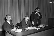 18/04/1963<br /> 04/18/1963<br /> 18 April 1963<br /> Closed circuit telephonic Pig Production meeting at the R.D.S., Dublin. Meetings on pig production were held simultaneously at the R.D.S. and Preston, Lancashire using closed circuit telephonic link. The meetings were sponsored by Smith, Kline and French Laboratories Ltd. and Goodbodys Ltd. Picture shows, J. Joyce, Chairman Rath Co-op, Co. Carlow, addressing the meeting. Included (l-r) W.E. Fletcher, M.R.C.V.S. speaker and W.R. Day, Department of Agriculture who presided.