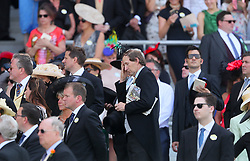 Racegoers observe a minutes silence in tribute to the recent tragedies in London and Manchester during day one of Royal Ascot at Ascot Racecourse.