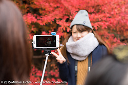 Japanese tourists sightseeing, Kyoto, Japan. December 10, 2015.  Photography ©2015 Michael Lichter.