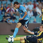 Ales Brosque shoots as he is challenged by Alex Wilkinson in during the Sydney FC V Central Coast Mariners A-League match at the Sydney Football Stadium, Sydney, Australia, 23 December 2009. Photo Tim Clayton