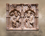 Gothic alabaster relief sculpture of two profits by Pere Oller, circa 1415, from the convent del Carme, Girona, Spain..  National Museum of Catalan Art, Barcelona, Spain, inv no: MNAC 214163 .<br /> <br /> If you prefer you can also buy from our ALAMY PHOTO LIBRARY  Collection visit : https://www.alamy.com/portfolio/paul-williams-funkystock/gothic-art-antiquities.html  Type -     MANAC    - into the LOWER SEARCH WITHIN GALLERY box. Refine search by adding background colour, place, museum etc<br /> <br /> Visit our MEDIEVAL GOTHIC ART PHOTO COLLECTIONS for more   photos  to download or buy as prints https://funkystock.photoshelter.com/gallery-collection/Medieval-Gothic-Art-Antiquities-Historic-Sites-Pictures-Images-of/C0000gZ8POl_DCqE
