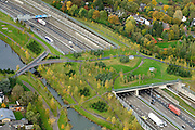 Nederland, Noord-Brabant, Gemeente Breda, 23-10-2013; Infrabundel, combinatie van autosnelweg A16 gebundeld met de spoorlijn van de HSL (re). Stadsduct Overbos in de voorgrond. De bundel loopt in tunnelbakken, lokale wegen gaan over deze infrabundel heen, door middel van de zogenaamde stadsducten, gedeeltelijk ingericht als stadspark. Combination of motorway A16 and the HST railroad, crossed by local roads by means of *urban ducts*, partly designed as public parks.<br /> luchtfoto (toeslag op standard tarieven);<br /> aerial photo (additional fee required);<br /> copyright foto/photo Siebe Swart