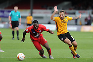 Femi Ilesanmi of York city  breaks away from Newport's Danny Holmes. . Skybet football league two match, Newport county v York city at Rodney Parade in Newport, South Wales on Saturday 5th Sept 2015.  pic by Andrew Orchard, Andrew Orchard sports photography.