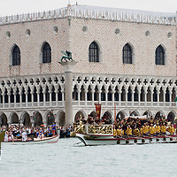 VENICE, ITALY - SEPTEMBER 04:  Rowers wearing costumes reproducing outfits dating back to 1489 take part in the Historic Regata in front of Palazzo Ducale on September 4, 2011 in Venice, Italy. The Historic Regata is the most popular boat race on the Gran Canal for locals and tourists alike. Doge Palace is the former Doge's residence and the seat of Venetian government, the Palace is the very symbol of Venice and a masterpiece of Gothic architecture.