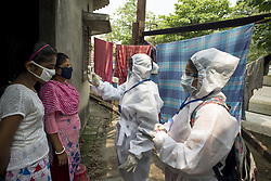KMC (Kolkata Mucicipal corporation) health workers check for fever among residents of a slum area in Kolkata midst the 2nd phase of lockdown in India due to covid 19 pandemic. This is to curb the spread of Covid 19 in the country. The second phase is handled with more strict rules by the administration. Kolkata, West Bengal, India April 23, 2020 Photo by Arindam Mukherjee/ABACAPRESS.COM