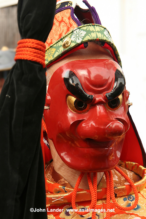 Long Nosed Mengake Mask at  Mengake Parade Procession at Goryo Jinja shrine.  At this festival a group of ten people take part in this annual ritual: 8 men and 2 women. Wearing grotesque or comical masks  leave the shrine and parade through the nearby streets accompanied by portable shrine and festival music.