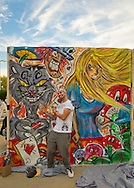 Garden City, New York, USA. 14th September 2014. JEAN PAUL SALIBA, aka Draft, of Farmingdale, is a graffiti artist creating an outdoor mural of Alice in Wonderland characters, at the United Ink Flight 914 tattoo convention at the Cradle of Aviation museum of Long Island.