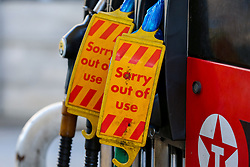 © Licensed to London News Pictures. 29/09/2021. London, UK. 'Sorry out of use' signs displayed on the pumps at Texaco petrol station in Hackney, north London as the station runs out of motor fuel on the sixth day of the fuel crisis. According to the government, 75 army tanker drivers have been put on standby to deliver motor fuel in order to ease the chaos at petrol stations. Photo credit: Dinendra Haria/LNP