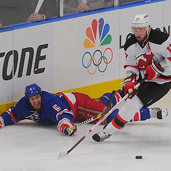 May 16, 2012: New York Rangers defenseman Dan Girardi (5) dives to poke the puck away from New Jersey Devils left wing Ilya Kovalchuk (17) during first period action in game 2 of the NHL Eastern Conference Finals between the New Jersey Devils and New York Rangers at Madison Square Garden in New York, N.Y.