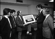 Tory Island Painters Exhibition.1985..05.03.1985..03.05.1985.5th March 1985..At Bord na Gaeilge Headquarters,Dublin an exhibition of painting was held to celebrate the work of Tory Island Painters. In attendance was the Minister for Finance Mr Alan Dukes T.D...Image of the Minister for Finance, Mr Alan Dukes TD, as the artist Mr Patsy Dan Mac Ruaidhri discusses his work. Included in the picture are (L-R) Mr Michael Finbar Mac Ruairi, Mr Ruairi L Mac Ruairi and the Chief Executive of Bord Na Gaeilge, Mr Michael Grae.