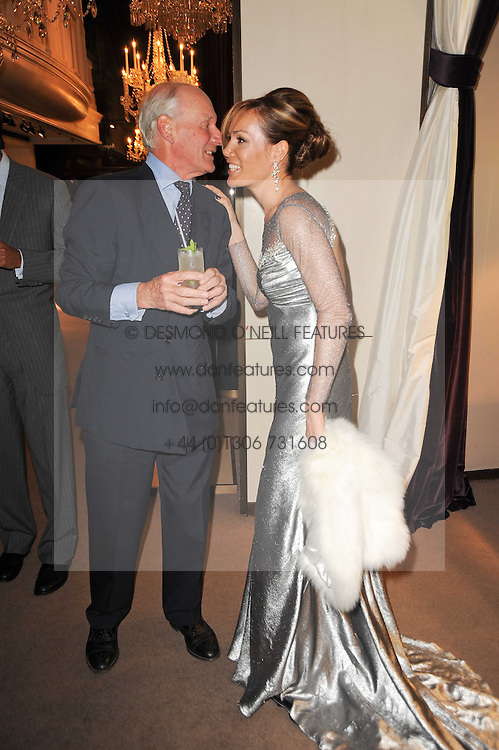 CHARLES PALMER-TOMKINSON and his daughter TARA PALMER-TOMKINSON at a party to celebrate the publication of Inheritance by Tara Palmer-Tomkinson at Asprey, 167 New Bond Street, London on 28th September 2010.