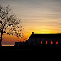 The setting sun's rays growl through the windows of the Sandy Hook Chapel, Sandy Hook New Jersey