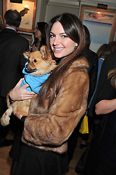 NATALIA WALTER and her dog Bear at the launch of George's Dinner for Dogs menu in aid of The Dog's Trust held at George, 87-88 Mount Street, London on 19th March 2013.