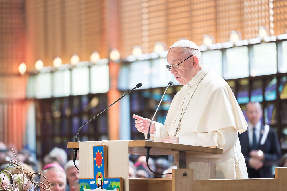 """21 June 2018, Geneva, Switzerland: On 21 June 2018, the World Council of Churches receives a visit from Pope Francis of the Roman Catholic Church. Held under the theme of """"Ecumenical Pilgrimage - Walking, Praying and Working Together"""", the landmark visit is a centrepiece of the ecumenical commemoration of the WCC's 70th anniversary. The visit is only the third by a pope, and the first time that such an occasion was dedicated to visiting the WCC. Here, an ecumenical prayer service with religious leaders from all over the world. Here, Pope Francis."""