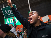 01 MARCH 2020 - ST. LOUIS PARK, MINNESOTA: A Black Lives Matter protester thrusts his fist into the air during a protest against Sen. Amy Klobuchar. Dozens of Black Lives Matter (BLM) protesters disrupted Sen. Amy Klobuchar's last presidential election rally in Minnesota before Super Tuesday. Almost 500 Klobuchar supporters came to hear Sen. Klobuchar, when the BLM protesters marched into the hall and took control of the stage. Klobuchar cancelled the event about an hour after the BLM protesters entered the hall. The protesters targeted Klobuchar because while she was the Hennepin County Attorney, she oversaw the conviction of Myon Burrell, a black teenager accused and convicted of murder. Evidence has come to light since his conviction that suggests he was wrongly convicted. His conviction has become a flashpoint in Minnesota politics.     PHOTO BY JACK KURTZ