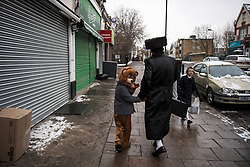 © Licensed to London News Pictures. 01/03/2018. London, UK. An orthodox Jewish boy dressed as a bear, looks over his shoulder while walking through the streets of Stamford Hill in north London, during celebrations for the festival of Purim on March 1, 2018. Purim celebrates the miraculous salvation of the Jews from a genocidal plot in ancient Persia, an event documented in the Book of Esther. Traditionally the jewish community wear fancy dress and exchange reciprocal gifts of food and drink. Photo credit: Ben Cawthra/LNP