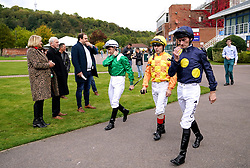 Jockeys Daniel Tudhope (right), Andrea Atzeni and Neil Callan make their way out ahead of the British EBF Maiden Fillies' Stakes at Nottingham Racecourse. Picture date: Wednesday October 13, 2021.
