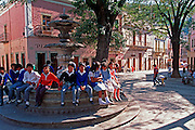 MEXICO, GUANAJUATO Plaza San Fernando and school children