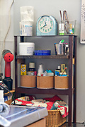 cleaning, make up and other objects on little shelf in kitchen