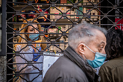 Pharmacy sells protective masks through the closed curtain in Milan, Italy on April 18, 2020. Daily life scenes with the new anti-COVID-19 Coronavirus prevention measures. Photo by Carlo Cozzoli/IPA/ABACAPRESS.COM