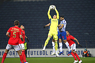Benfica's goalkeeper Odisseas Vlachodimos in action with Mehdi Taremi of Porto during the Portuguese First League match between FC Porto and Benfica at Estadio do Dragao, Portugal on 15 January 2021.