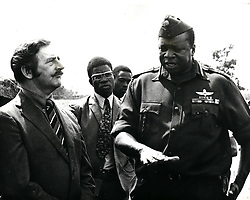 Dec. 12, 1968 - What Happened to Uganda's Asian Citizens? With Uganda's President Idi Amin decreed that the non citizen Asians must go, it was said that there were 8,000 citizens who presumably would stay. When stay were counted recently, only a few hundreds appeared. The exodus which followed the President's order to all non citizen Asians to quit the country has resuleted in the departure of at least 45,000 people - many of them to England, others to Canada, the United States and elsewhere. Who is left? After initially saying that Asians who were Ugandan citizens must leave as well, President Amin changed his minds and said that they might after all remain. It was estimated at the time that there were at least 8,000 citizens who could take advantage of this clemency. Yet when Amin organised a head count after the expiry of the deadline for the Asians Departure, only a few hundred people appeared. What had happened to the rest? Photo Shows: A surprise visitor to the head counting General Amin and the United Nations' representative Mr. W. Prattley, who was in Kampala to help look after the 'stateless' Asians. (Credit Image: © Keystone Pictures USA/ZUMAPRESS.com)