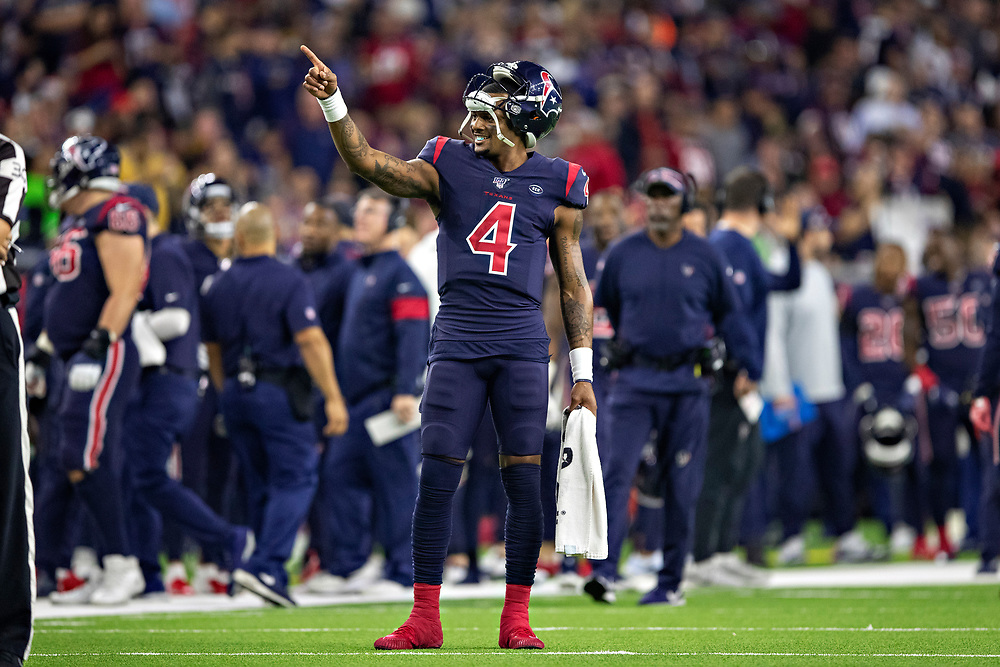HOUSTON, TX - DECEMBER 1:  Deshaun Watson #4 of the Houston Texans points to someone in the stands during the second half of a game against the New England Patriots at NRG Stadium on December 1, 2019 in Houston, Texas.  The Texans defeated the Patriots 28-22.  (Photo by Wesley Hitt/Getty Images) *** Local Caption *** Deshaun Watson