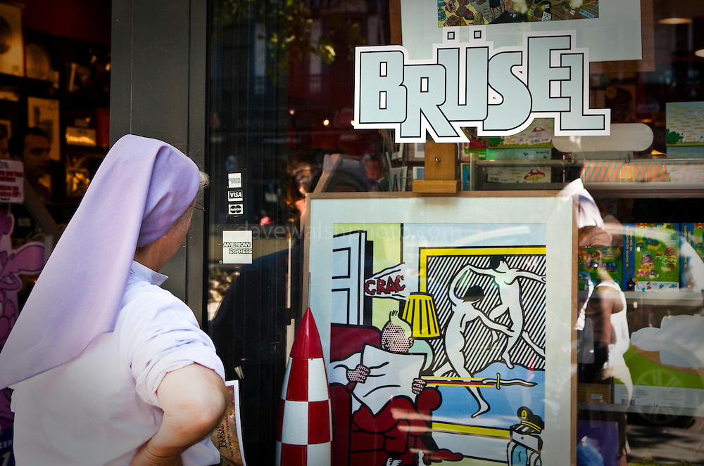 A nun checks out a frisky Tin Tin artwork in the window of a comic shop in Brussels.