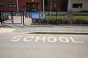 School sign painted on road